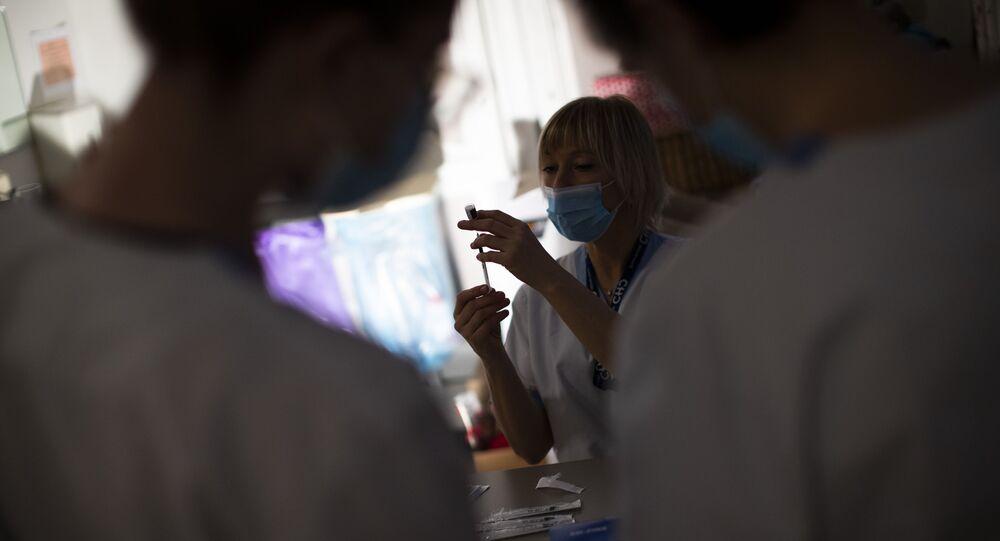 A nurse prepares a syringe with the Pfizer/Biontech COVID-19 vaccine
