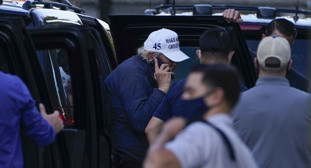 President Donald Trump talks on the phone as he arrives at the White House after golfing Saturday, Nov. 7, 2020, in Washington