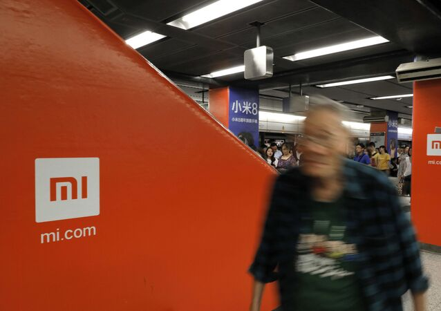 An advertisement for Xiaomi is displayed at a subway station in Hong Kong, 9 July 2018