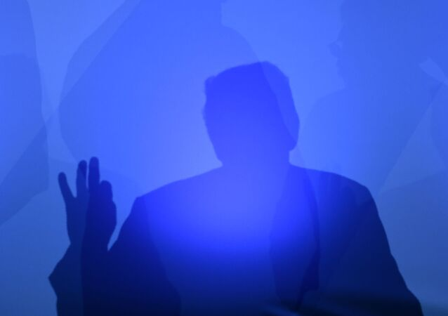 US President Donald Trump casts a shadow as he addresses a press conference on the second day of the North Atlantic Treaty Organization (NATO) summit in Brussels on July 12, 2018