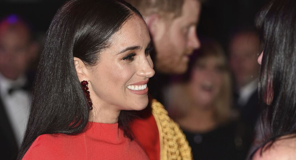 Britain's Prince Harry and Meghan, Duchess of Sussex, attend the Mountbatten Festival of Music at the Royal Albert Hall in London, Saturday, 7 March 2020.