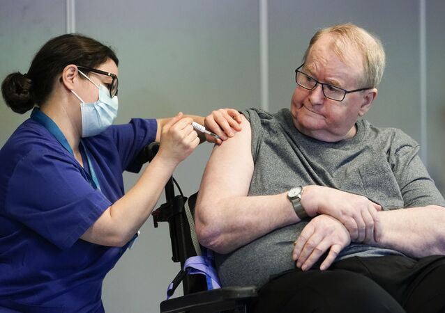 Svein Andersen, 67 years-old resident of 'Ellingsrud home' and first in Norway to receive the vaccine is given the Pfizer-Biontech Covid-19 corona virus vaccine by Nurse Maria Golding in Oslo, Norway, on December 27, 2020.