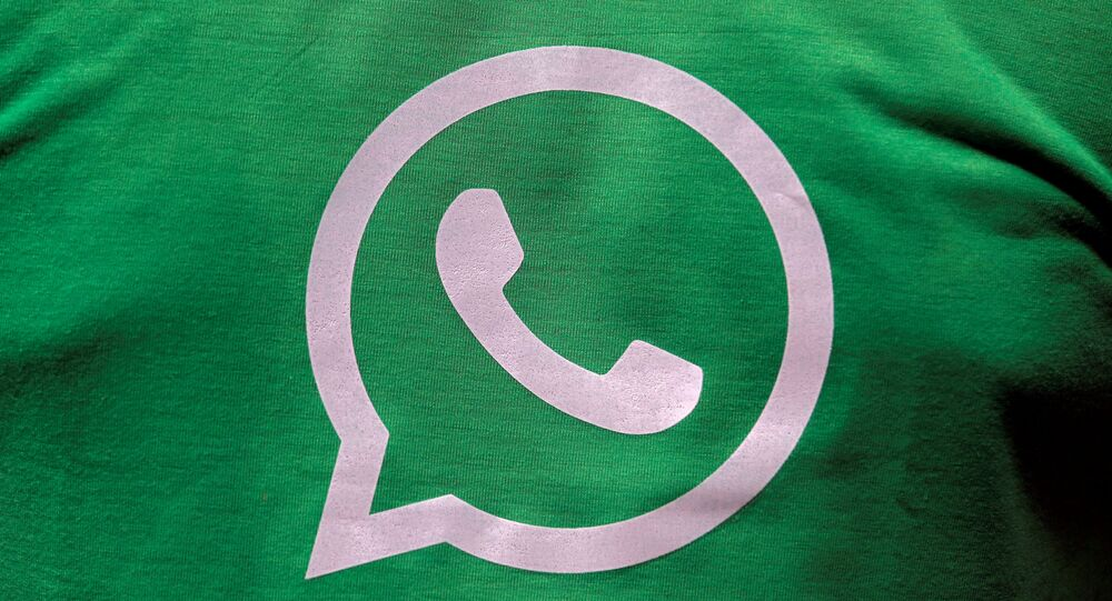 A logo of WhatsApp is pictured on a T-shirt worn by a WhatsApp-Reliance Jio representative during a drive by the two companies to educate users