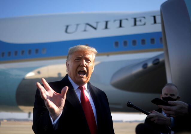 U.S. President Donald Trump speaks to the media before boarding Air Force One to depart Washington on travel to visit the U.S.-Mexico border Wall in Texas, at Joint Base Andrews in Maryland, U.S., January 12, 2021.