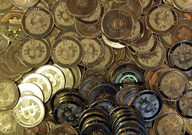 This April 3, 2013, file photo shows bitcoin tokens in Sandy, Utah. Unidentified hackers broke into the Twitter accounts of technology moguls, politicians, celebrities and major companies Wednesday, July 15, 2020, in an apparent Bitcoin scam