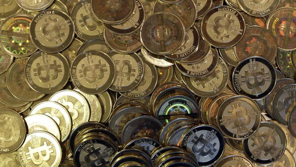 This April 3, 2013, file photo shows bitcoin tokens in Sandy, Utah. Unidentified hackers broke into the Twitter accounts of technology moguls, politicians, celebrities and major companies Wednesday, July 15, 2020, in an apparent Bitcoin scam - Sputnik International