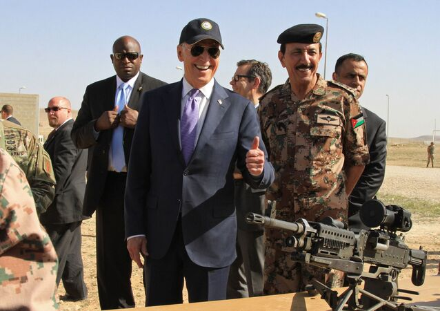 U.S. Vice President Joe Biden, left, visits a joint Jordanian-American training center at Zarqa, northeast of Amman, Jordan, Thursday, March 10, 2016. The Jordanian town was believed to include a training camp for Syrian rebels at the time of his visit.