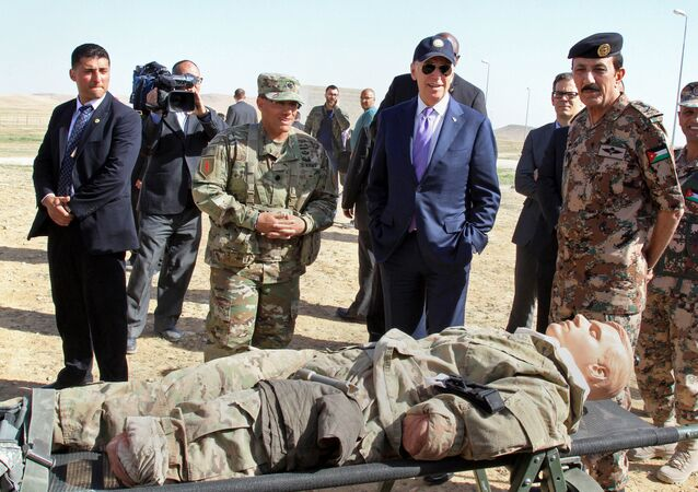 US Vice President Joe Biden, left, visits a joint Jordanian-American training centre at Zarqa, northeast of Amman, Jordan, 10 March 2016.