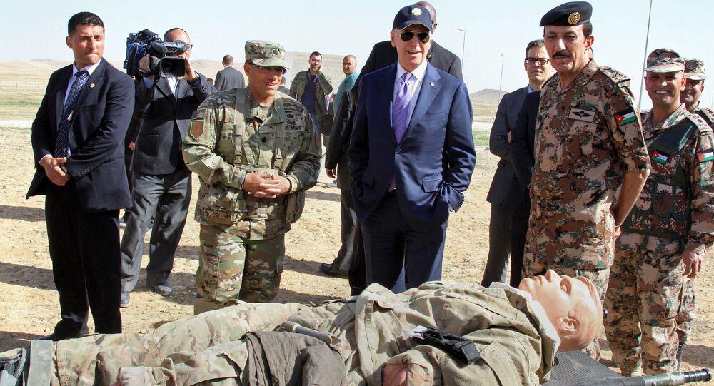 US Vice President Joe Biden, left, visits a joint Jordanian-American training centre at Zarqa, northeast of Amman, Jordan, 10 March 2016.