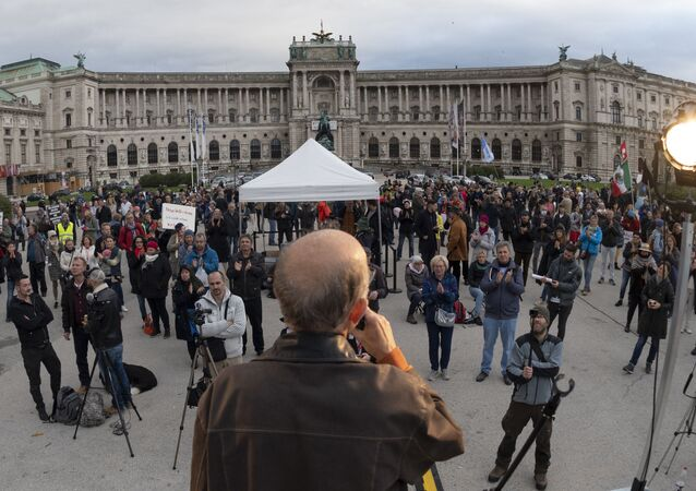 People attend a protest against Austrian government's restrictions implied due to the new corona virus Covid-19, outside of the Hofburg palace in Vienna, Austria on October 31, 2020.
