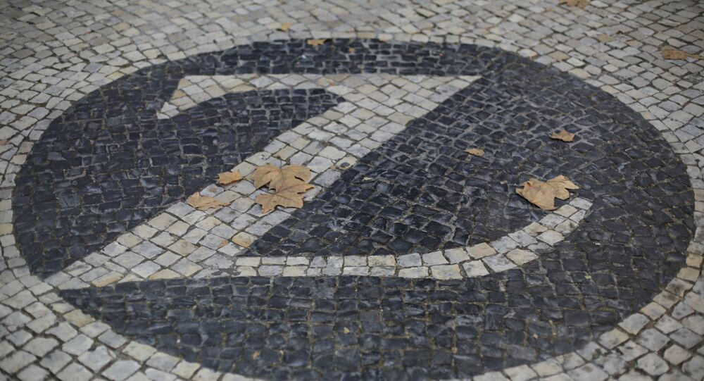 The logo of Swiss insurance company Zurich on the sidewalk outside their office in Lisbon, Portugual Wednesday, Sept. 16, 2020. (AP Photo/Armando Franca)
