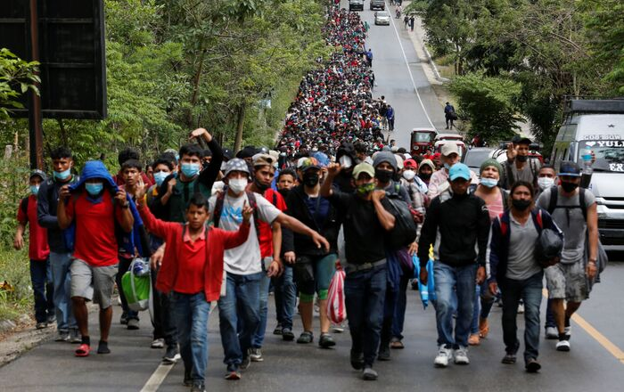 Hondurans taking part in a new caravan of migrants set to head to the United States, walk along a road in El Florido, Guatemala January 16, 2021.