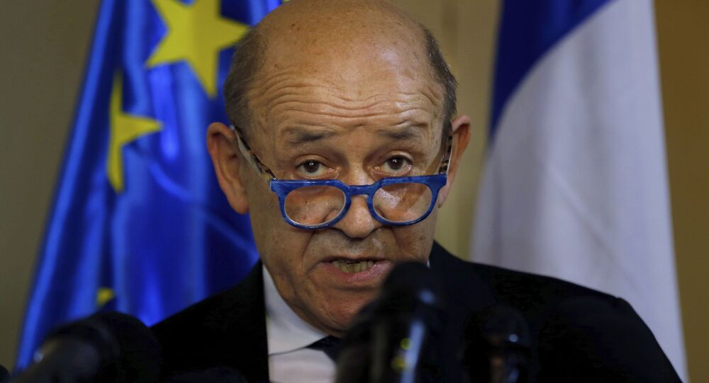 French Foreign Minister Jean-Yves Le Drian, and his Lebanese counterpart Nassif Hitti, hold a news conference following their meeting at the Lebanese foreign ministry in Beirut, Lebanon, Thursday, July. 23, 2020. Le Drian met with Lebanon's president Thursday at the start of his two-day visit to the Mediterranean country that is witnessing the worst economic crisis of its modern history.