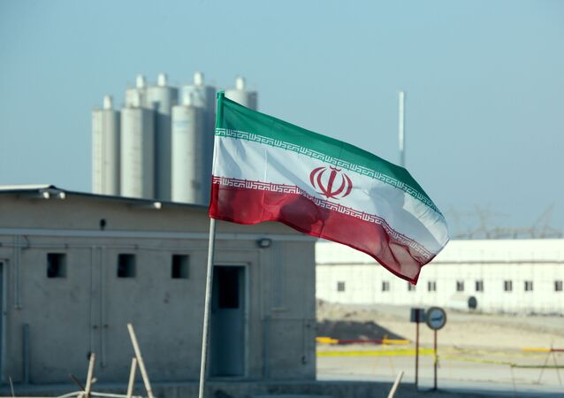 A picture taken on November 10, 2019, shows an Iranian flag in Iran's Bushehr nuclear power plant, during an official ceremony to kick-start works on a second reactor at the facility. - Bushehr is Iran's only nuclear power station and is currently running on imported fuel from Russia that is closely monitored by the UN's International Atomic Energy Agency.