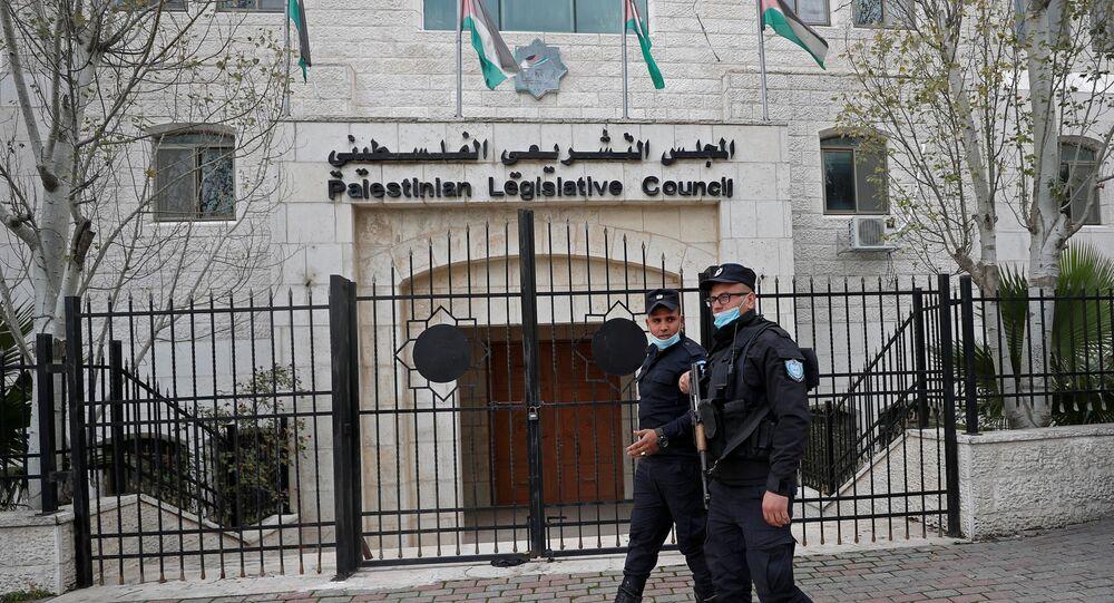 Palestinian policemen guard outside the Palestinian legislative council in Ramallah, in the Israeli-occupied West Bank January 16, 2021.