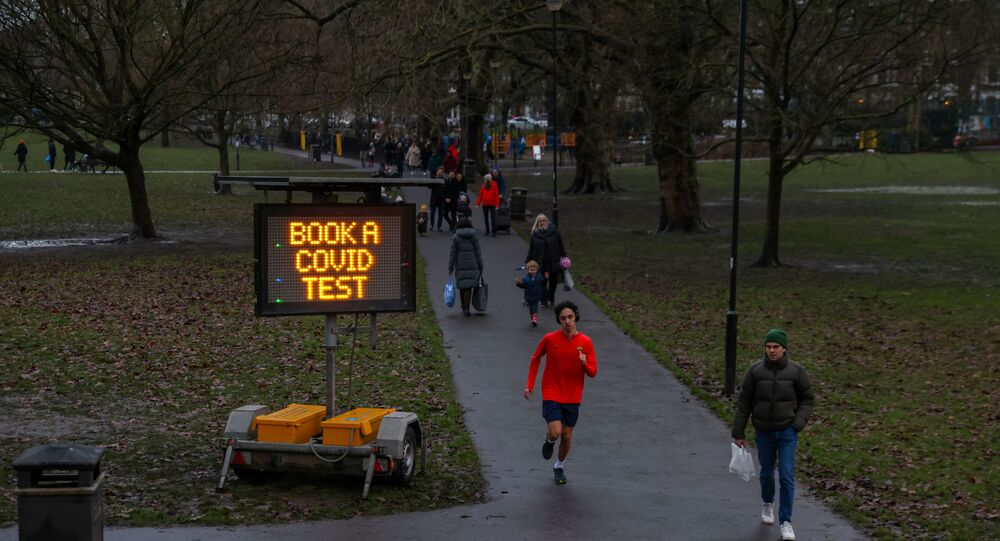 A sign urging local residents to book a COVID test is seen on Eel Brook Common as Britain continued its third COVID-19 lockdown in Fulham, London, Britain, January 16, 2021.