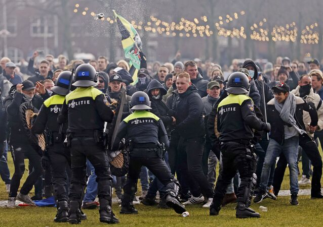 Riot police clashes with protesters during a demonstration in the Museumplein town square in Amsterdam, Netherlands, on January 17, 2021.