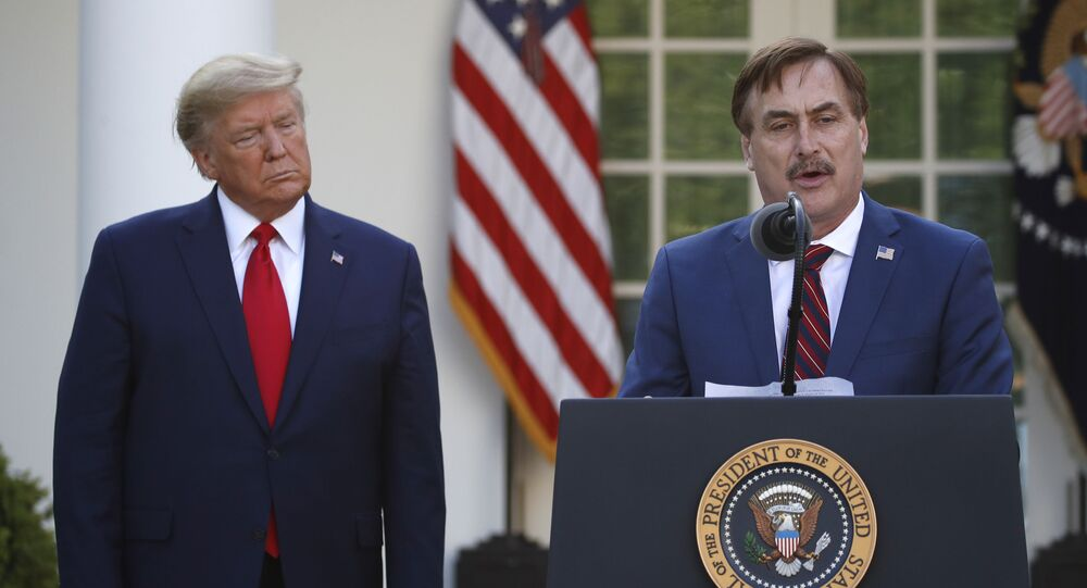 My Pillow CEO Mike Lindell speaks as President Donald Trump listens during a briefing about the coronavirus in the Rose Garden of the White House, Monday, March 30, 2020, in Washington