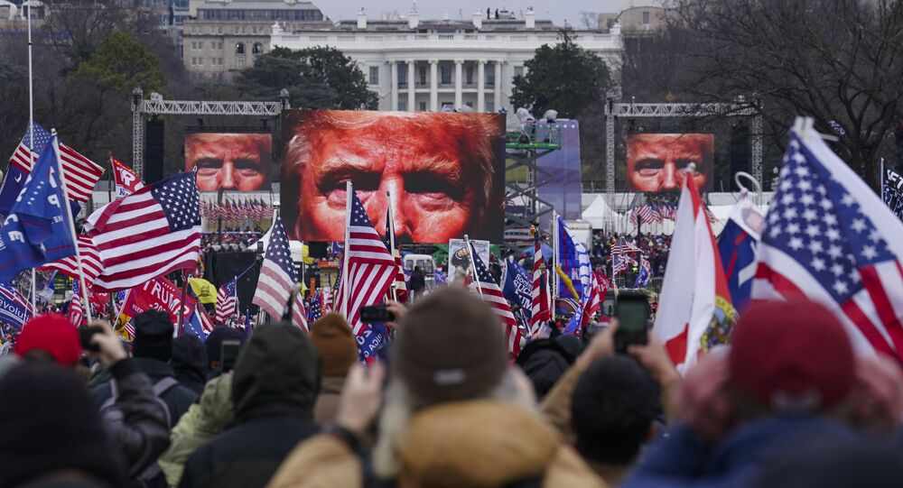 In this 6 January 2021 file photo, Trump supporters participate in a rally in Washington.  An AP review of records finds that members of President Donald Trump's failed campaign were key players in the Washington rally that spawned a deadly assault on the US Capitol.