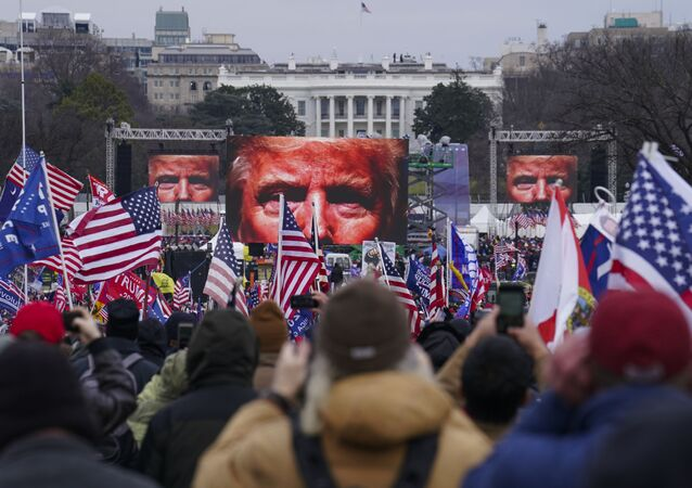 In this Jan. 6, 2021 file photo, Trump supporters participate in a rally in Washington.  An AP review of records finds that members of President Donald Trump's failed campaign were key players in the Washington rally that spawned a deadly assault on the U.S. Capitol last week.