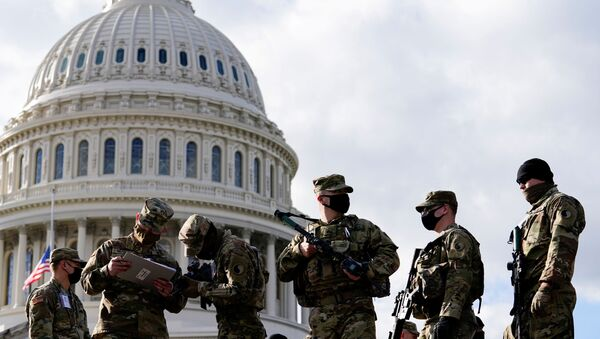 National Guard troops receive guns and ammunition outside the U.S. Capitol building as supporters of U.S. President Donald Trump are expected to protest against the election of President-elect Joe Biden, in Washington DC, U.S. January 17, 2021 - Sputnik International