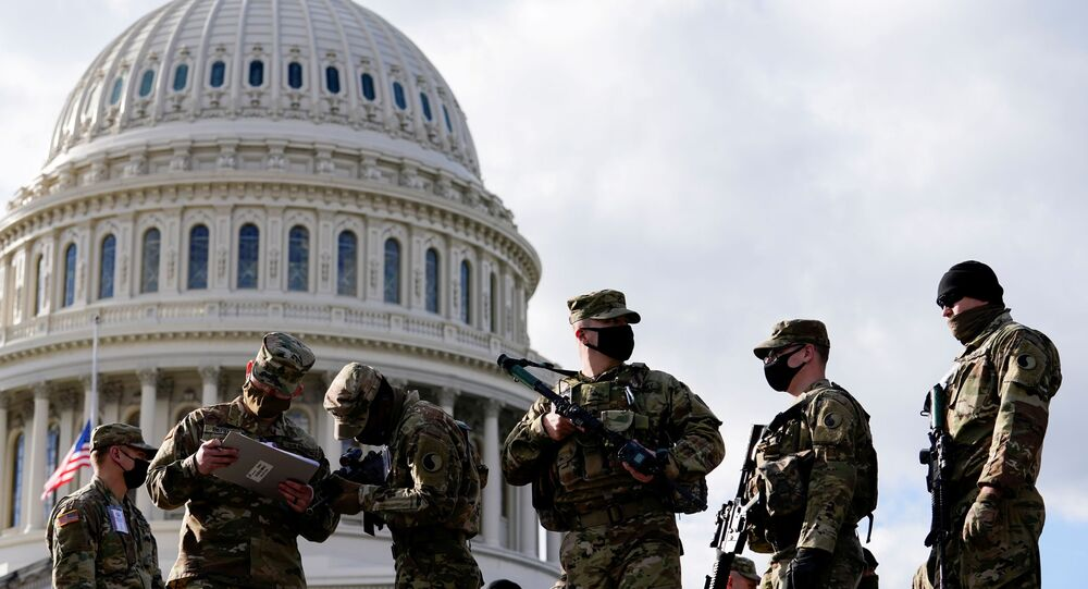 National Guard troops receive guns and ammunition outside the U.S. Capitol building as supporters of U.S. President Donald Trump are expected to protest against the election of President-elect Joe Biden, in Washington DC, U.S. January 17, 2021
