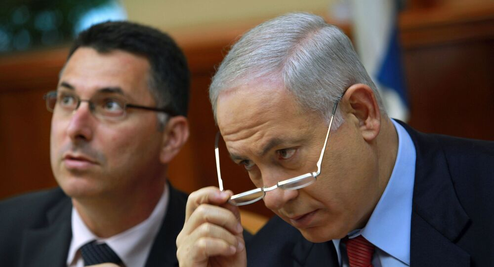 Israeli Prime Minister Benjamin Netanyahu, right, and Education Minister Gideon Saar, attend the weekly cabinet meeting in Jerusalem, Sunday, Oct. 18, 2009.