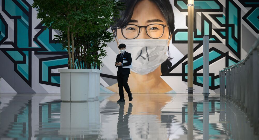 A staff member walks before a mural at Incheon international airport on December 29, 2020, amid the Covid-19 coronavirus pandemic