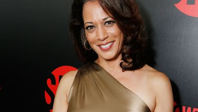 Then-California Attorney General Kamala Harris wears an elegant one-shoulder satin bodycon gown at Showtime's 2012 EMMYEVE Soiree held at Sunset Tower on 22 September 2012 in West Hollywood, California.