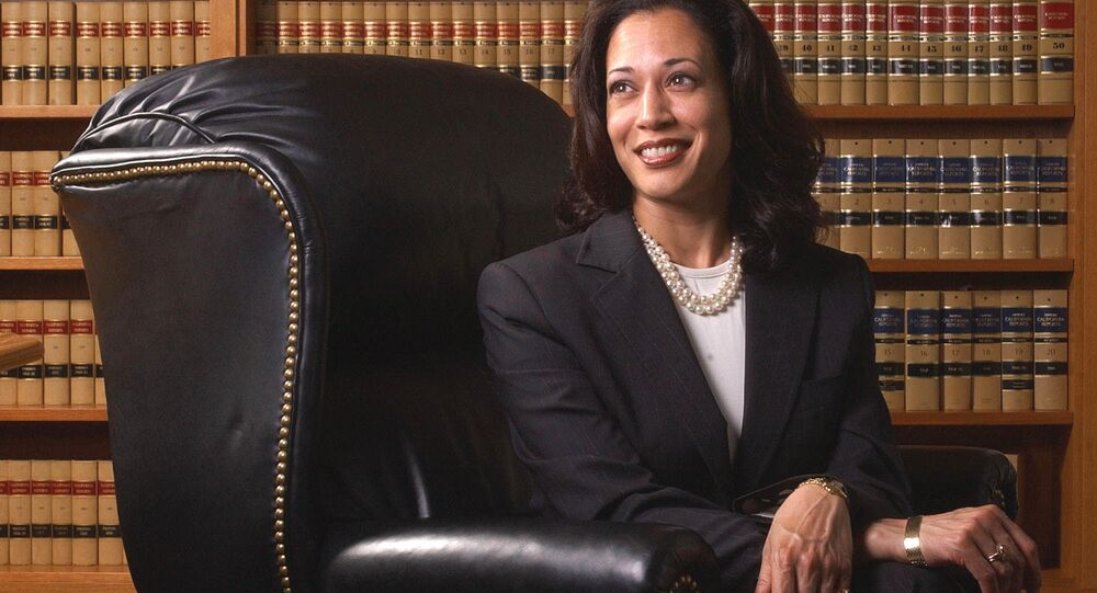 The then San Francisco District Attorney Kamala Harris poses for a portrait in San Francisco on 18 June 2004, in a black suit, accentuated with a strand of white pearls and a white tee.