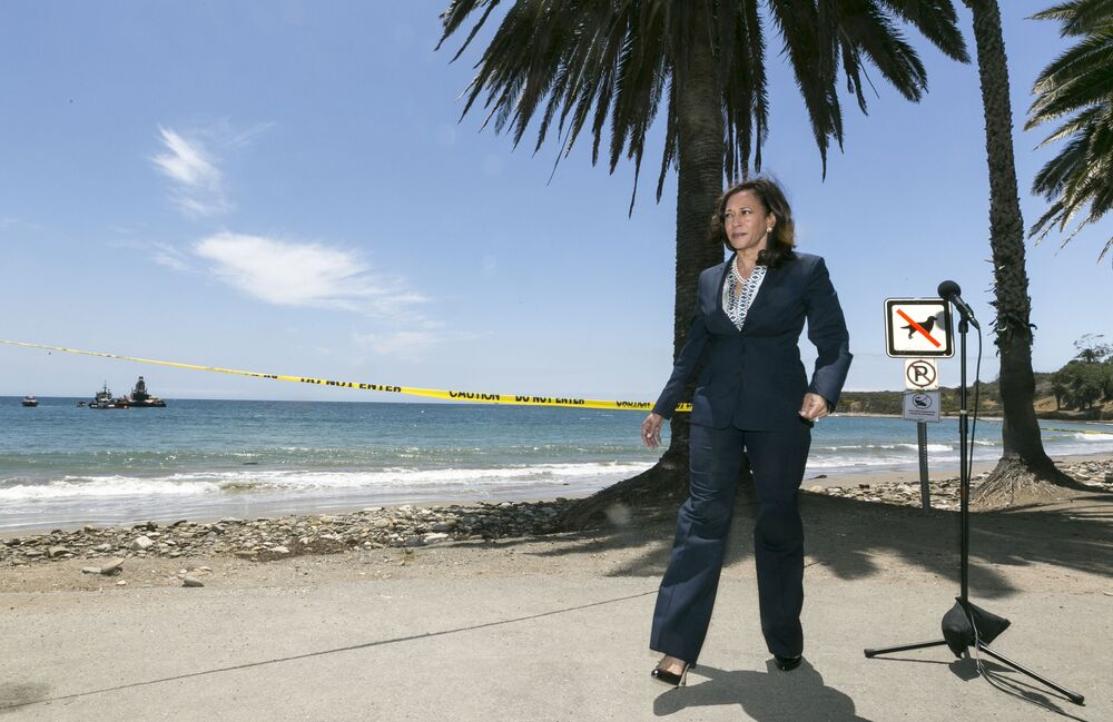 California Attorney General Kamala Harris tours the oil spill clean-up at Refugio State Beach, north of Goleta, Calif., on Thursday, 4 June 2015, wearing a signature pantsuit, stilettos, and a pearl necklace.