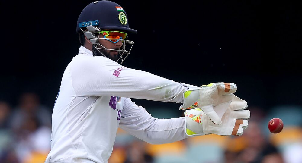 India's wicketkeeper Rishabh Pant fields the ball on day four of the fourth cricket Test match between Australia and India at The Gabba in Brisbane on January 18, 2021.