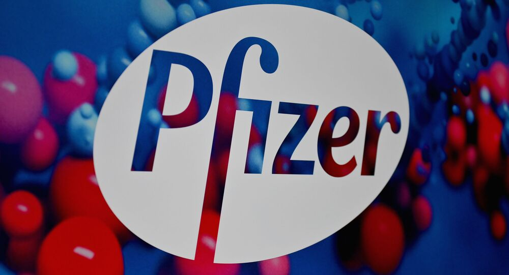 The Pfizer logo is seen at the Pfizer Inc. headquarters on December 9, 2020 in New York City