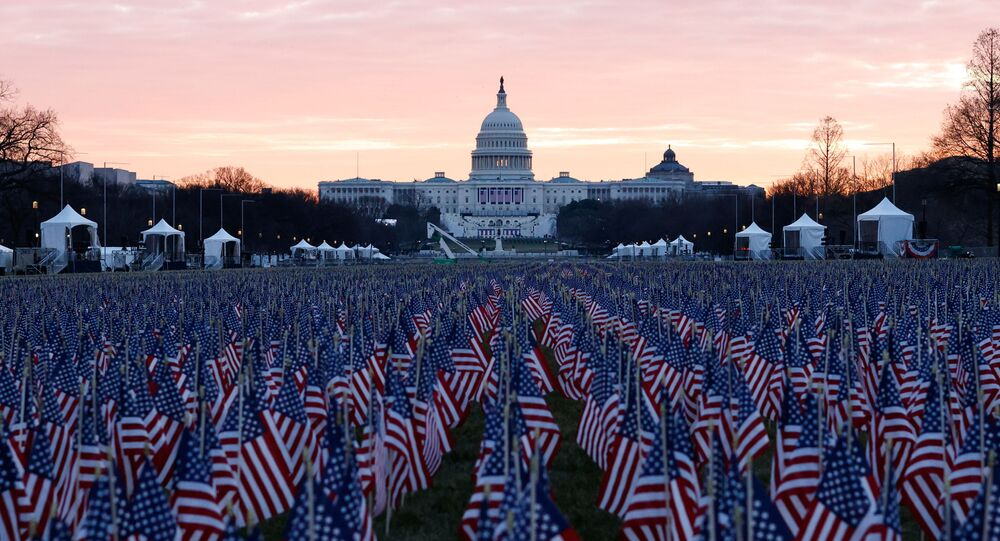 Thousands of US flags are seen at the National Mall, as part of a memorial paying tribute to the more than 200,000 people nationwide who have died from the coronavirus disease (COVID-19), near the US Capitol ahead of President-elect Joe Biden's inauguration, in Washington, DC, US, 18 January 2021.