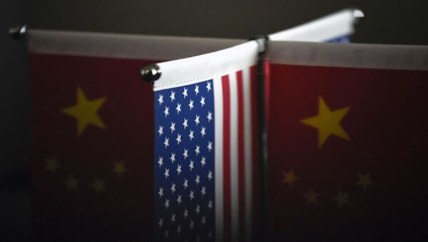 Chinese flags and American flags are displayed in a company in Beijing on August 16, 2017 - Sputnik International