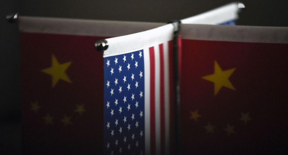 Chinese flags and American flags are displayed in a company in Beijing on August 16, 2017