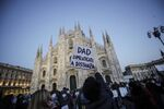 Students, parents and teachers gather in front of the Duomo gothic cathedral, in Milan, Italy,  to protest against the Lombardy's government decision to delay reopening of high schools until Jan. 24 amid an extension of its anti-covid measures, Friday, Jan. 8, 2021