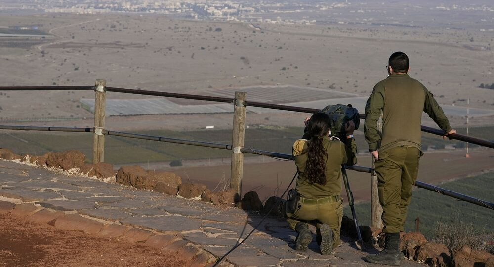 Israeli soldiers observe Al Qunaitra, Syria, across the border from Mount Bental in the Israeli-controlled Golan Heights, Thursday, Nov. 19, 2020, prior to a visit by Secretary of State Mike Pompeo and Israel's Foreign Minister Gabi Ashkenazi.