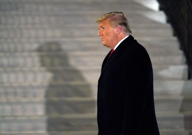 In this Tuesday, Jan. 12, 2021, file photo, President Donald Trump arrives on the South Lawn of the White House, in Washington, after returning from Texas.