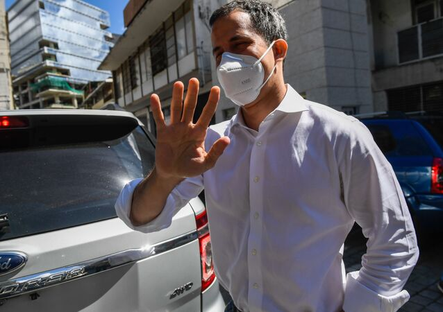 Venezuelan opposition leader Juan Guaido arrives to deliver a press conference during the popular consultation day at Bolivar Square in Chacao, eastern Caracas, on December 12, 2020.
