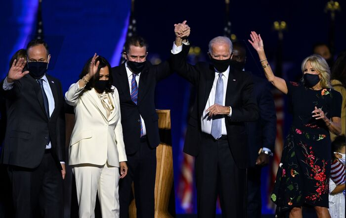 (From L) Husband of Vice President-elect Kamala Harris, Douglas Emhoff, Vice President-elect Kamala Harris, Hunter Biden, US President-elect Joe Biden and wife Jill Biden salute the crowd after delivering remarks in Wilmington, Delaware, on November 7, 2020, after being declared the winners of the presidential election. (Photo by Jim WATSON / AFP)