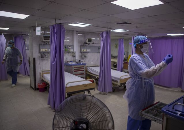 Palestinian doctors wear protective clothes as they work at the emergency room of the al-Quds Hospital in Gaza City, Monday, Sept. 7, 2020. Dozens of front-line health care workers have been infected, dealing a new blow to overburdened hospitals.