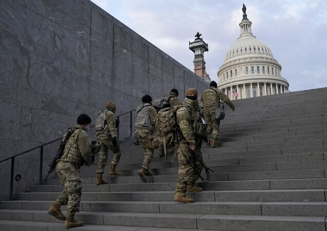 National Guard members take a staircase toward the U.S. Capitol building before a rehearsal for President-elect Joe Biden's Presidential Inauguration in Washington, Monday, Jan. 18, 2021