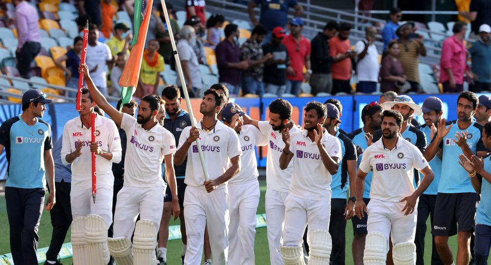 Indian players celebrate at the end of the fourth cricket Test match between Australia and India at The Gabba in Brisbane on January 19, 2021.