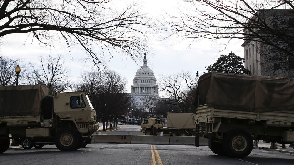 Military trucks block access to the Capitol ahead of US President-elect Joe Biden's inauguration, in Washington, DC, the US, 17 January 2021.