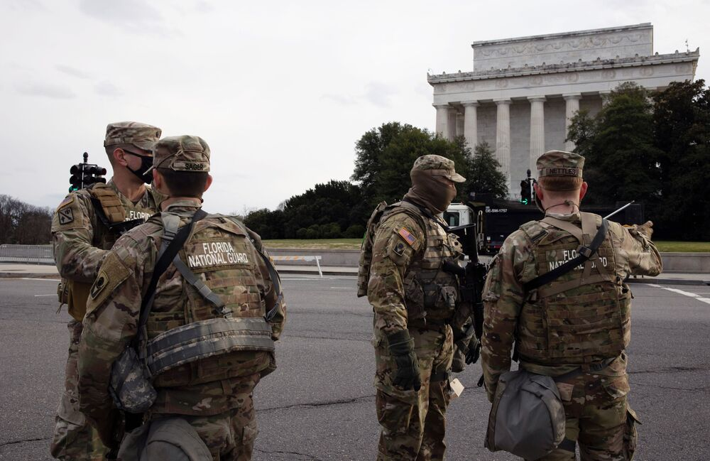 Soldiers of the National Guard on duty on a street near the Capitol Building in Washington, DC.