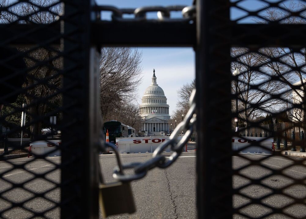 A metal fence on a street near the Capitol Building in Washington, DC.