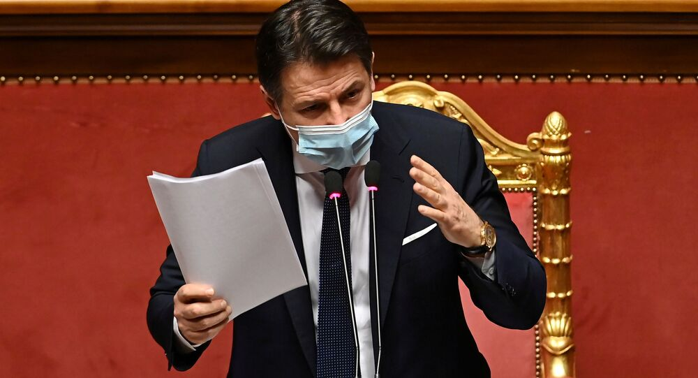 Italian Prime Minister Giuseppe Conte gestures as he addresses senators ahead of a confidence vote, at Palazzo Madama in Rome, Italy January 19, 2021
