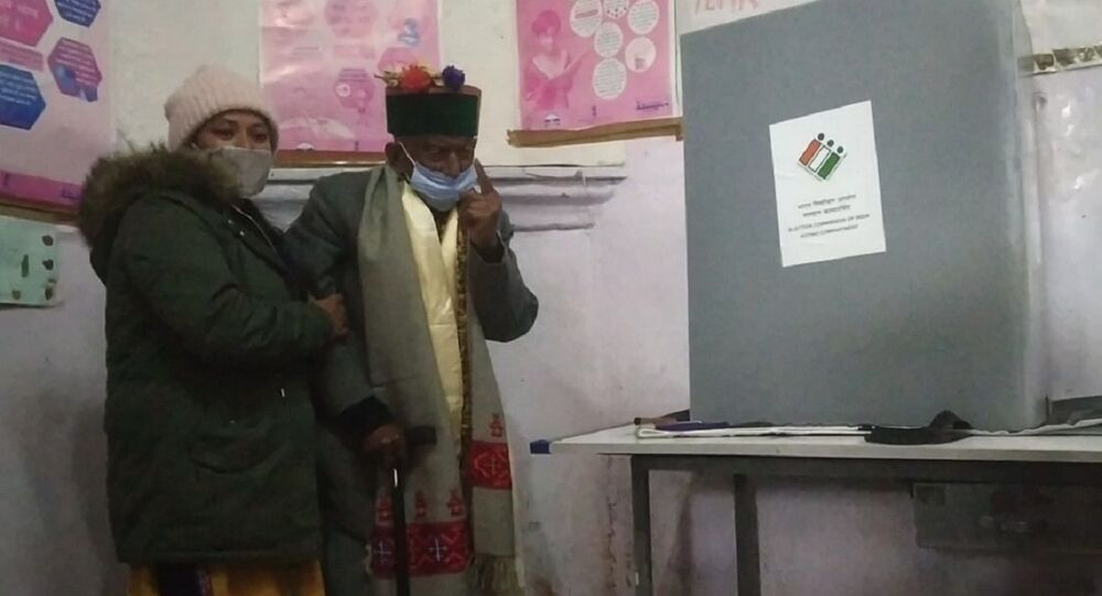 Shyam Saran Negi casting his vote inside the polling booth in Kalpa, Himachal Pradesh