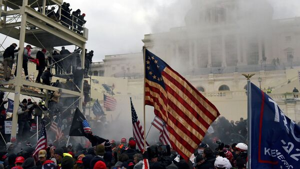 Supporters of US President Donald Trump protest in front of the Capitol Building in Washington, US 6 January 2021. REUTERS/Stephanie Keith/File Photo - Sputnik International